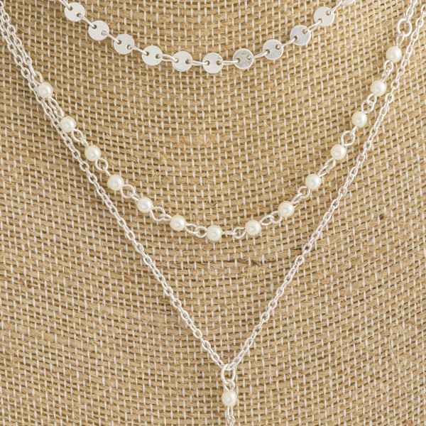 """Long layered Y metal necklace with pearl details. Approximate 26"""" in length."""