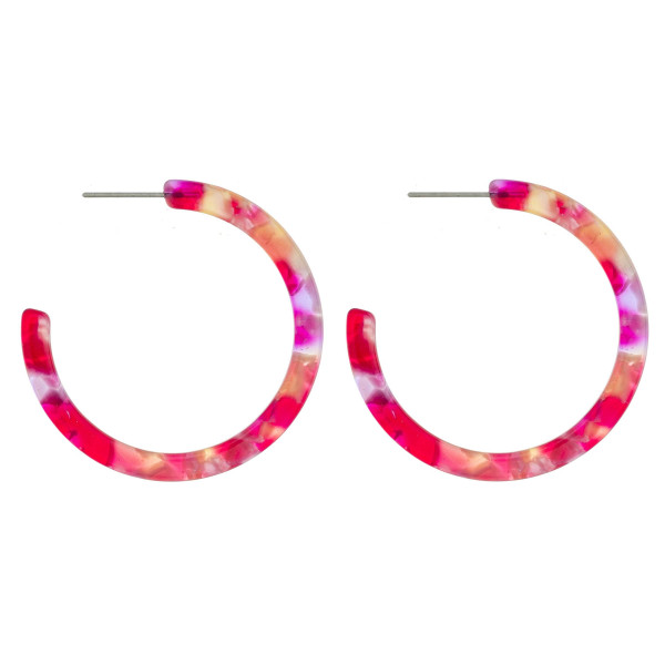 "Long acetate open hoop earring. Approximate 1.5"" in diameter."