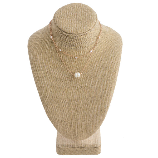 """Short metal necklace with pearl details. Approximate 13-15"""" in length."""