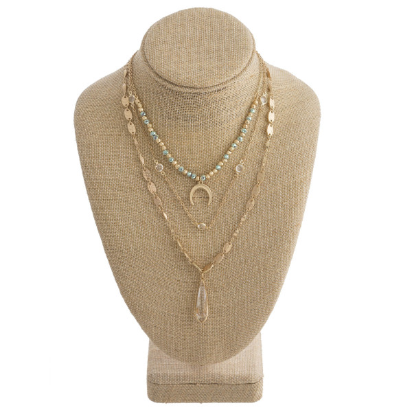 """Long metal and beaded layered necklace with horn and crystal pendants. Approximate 14-16-19"""" in  length."""
