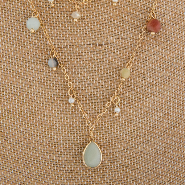 """Long layered metal necklace with natural stone charms and pendant. Approximate 16"""" in length."""