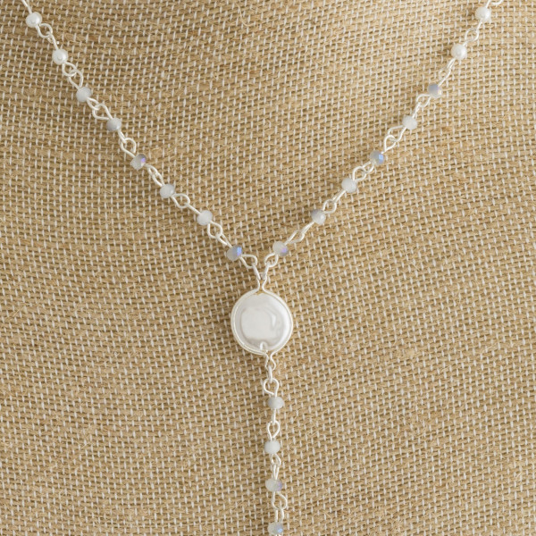 """Long Y necklace with pearl details. Approximate  32"""" in length."""