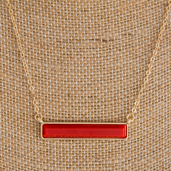 """Long metal necklace with bar pendant. Approximate 28"""" in length."""