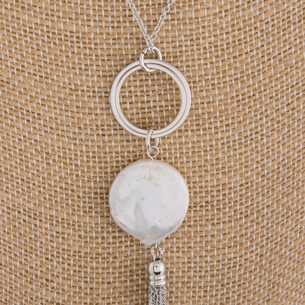 "Long metal necklace with pearl pendant. Approximate 32"" in length."