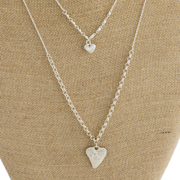 "Long metal necklace with heart pendant. Approximate 22"" in length."