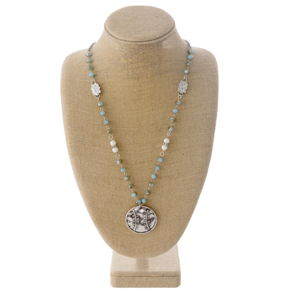 "Beaded chain necklace featuring a metal softball/baseball pendant with faceted bead details with pearl and silver accents. Pendant approximately 1.5"". Approximately 30"" in length overall."