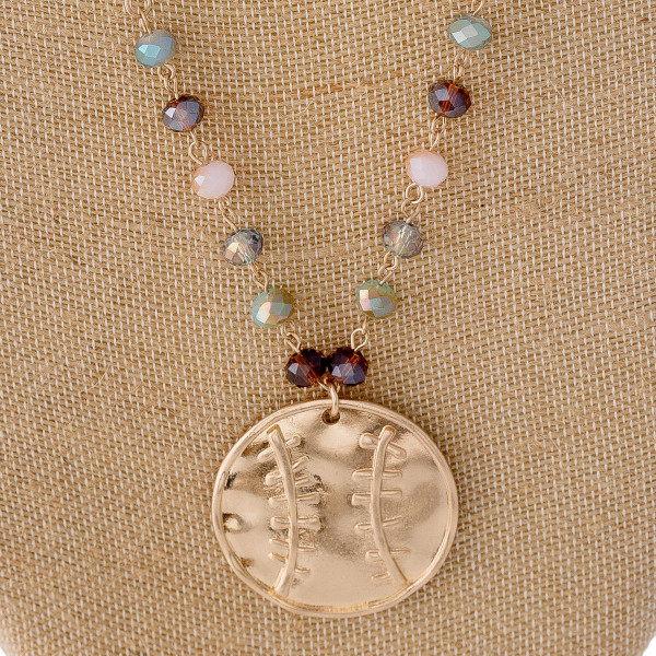 "Beaded chain necklace featuring a metal softball/baseball pendant with multicolor faceted bead details with pearl and silver accents. Pendant approximately 1.5"". Approximately 30"" in length overall."