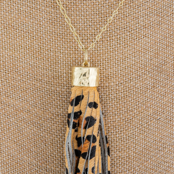 "Long metal crave necklace with animal tassel. Approximate 30"" in length."