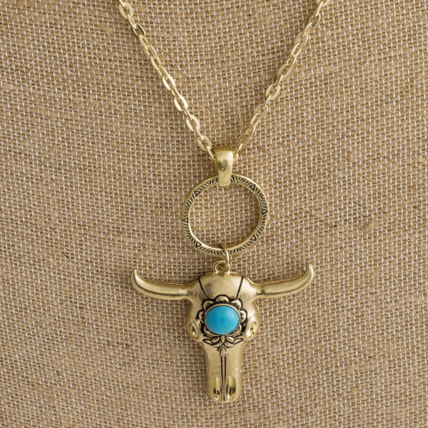 """Long metal necklace with steer head pendant. Approximate 26"""" in length."""