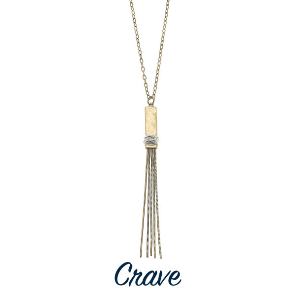 """Long metal necklace with tassel pendant. Approximate 20"""" in length."""