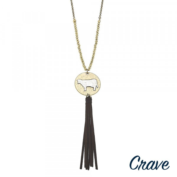 "Long metal necklace with cow pendant and tassel. Approximate 30"" in length.  Don't forget to grab the matching earrings."
