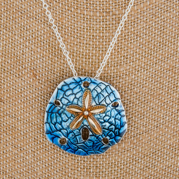 """Long metal beach necklace with flower pendant. Approximate 18"""" in length with 2"""" pendant."""