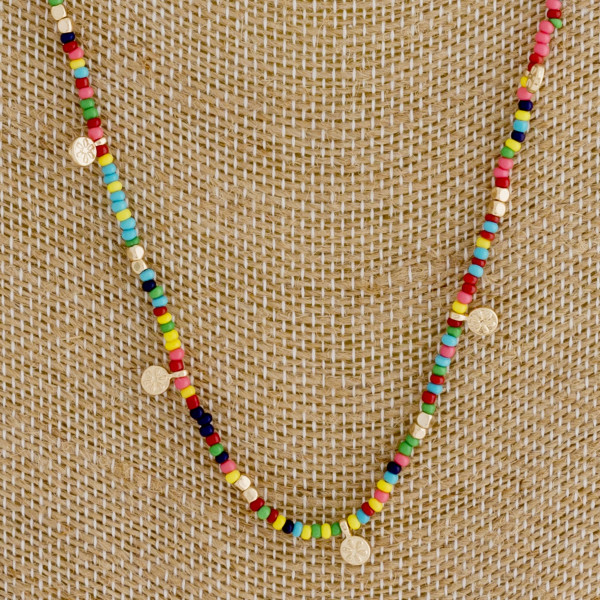 "Long multicolor beaded necklace with gold accents. Approximately 30"" in length."