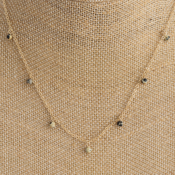 """Dainty metal necklace featuring beaded accents. Approximately 14"""" in length."""
