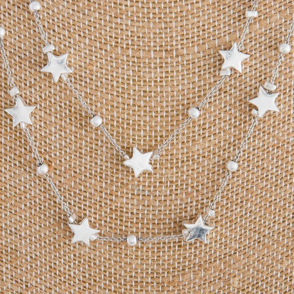 "Long metal layered star necklace. Approximate 18"" in length."