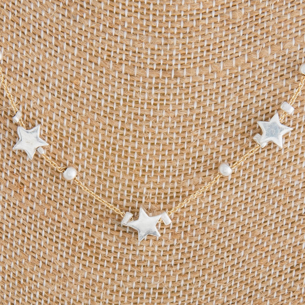 "Long metal necklace with stars. Approximate 16"" in length."
