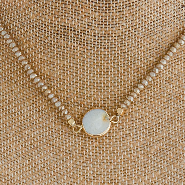 """Iridescent beaded necklace featuring a pearl accent. Approximately 12"""" in length."""
