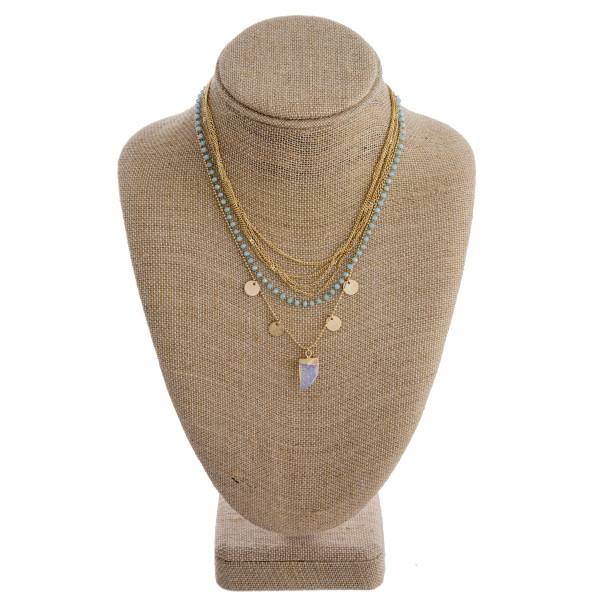 "Gold metal five layered necklace featuring a pave horn pendant with beaded details and gold accents. Pendant approximately .5"". Approximately 16"" in length overall."