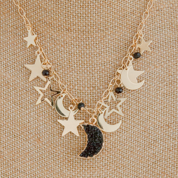 """Gold cable chain necklace featuring a druzy moon pendant with star and moon accents. Pendant approximately .75"""". Approximately 18"""" in length overall."""