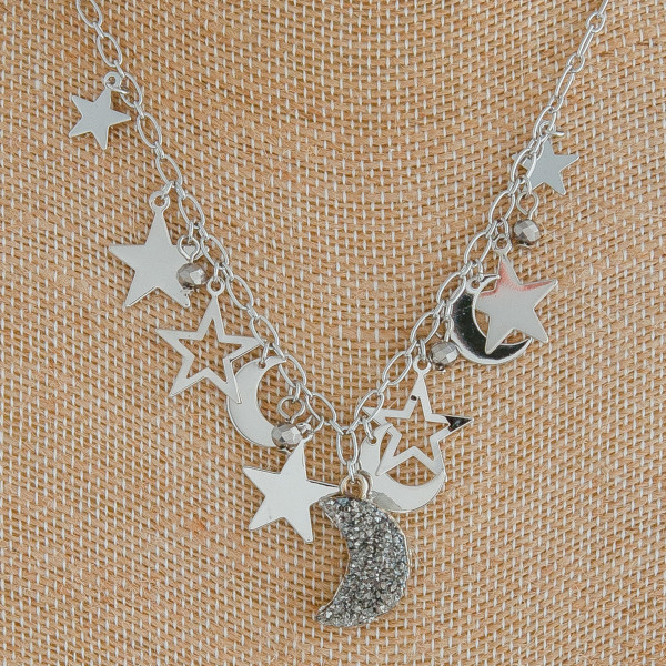 "Silver cable chain necklace featuring a druzy moon pendant with star and moon accents. Pendant approximately .75"". Approximately 18"" in length overall."
