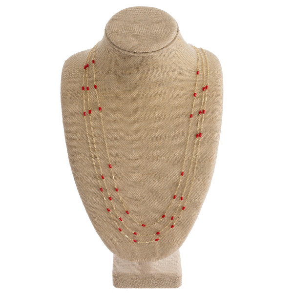 """Long multi layered necklace with bead details. Approximate 32"""" in length."""