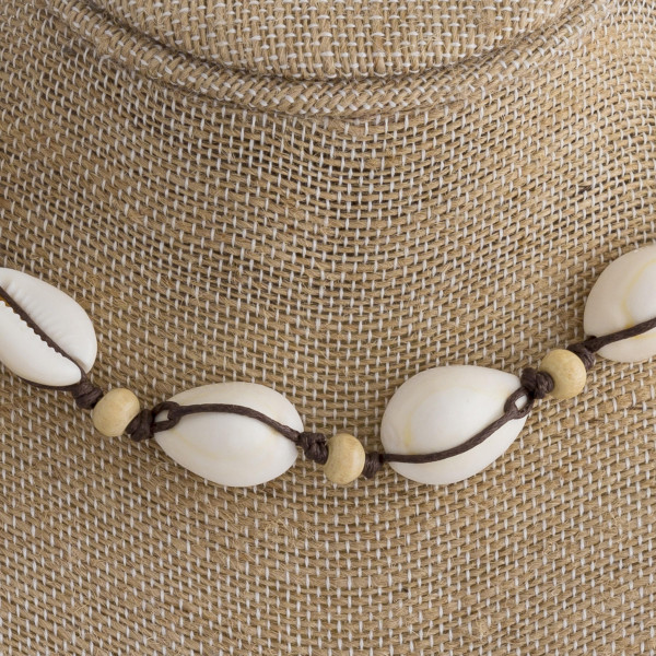 """Short rope necklace with seashells and bead details. Approximate 16"""" in length."""