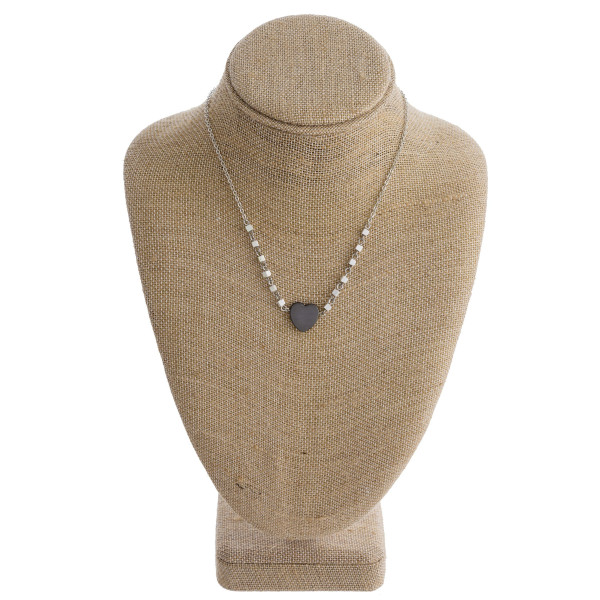 """Long metal necklace with bead and heart details. Approximate 16"""" in length."""