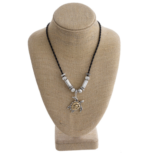 """Long leather braided necklace with turtle pendant. Approximate 17"""" in length."""