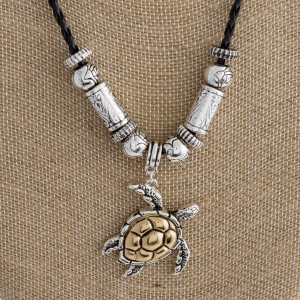 "Long leather braided necklace with turtle pendant. Approximate 17"" in length."