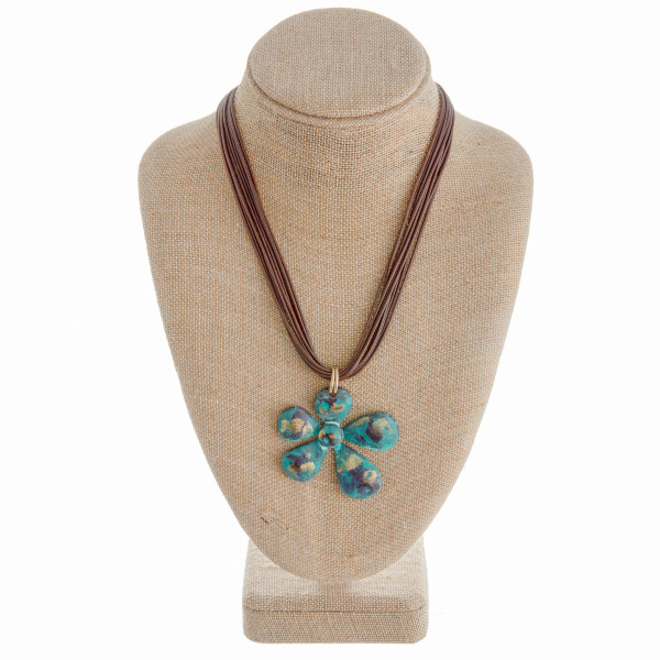 """Long multi strand necklace with flower pendant. Approximate 20"""" in length."""