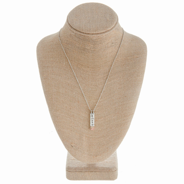 """Long metal necklace with engraved inspirational message """"Brave"""". Approximate 18"""" in length."""