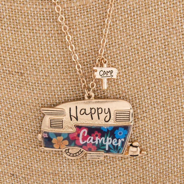 "Long metal necklace featuring ""Happy Camper"" pendant with floral details. Pendant approximately 1.5"". Approximately 32"" in length."