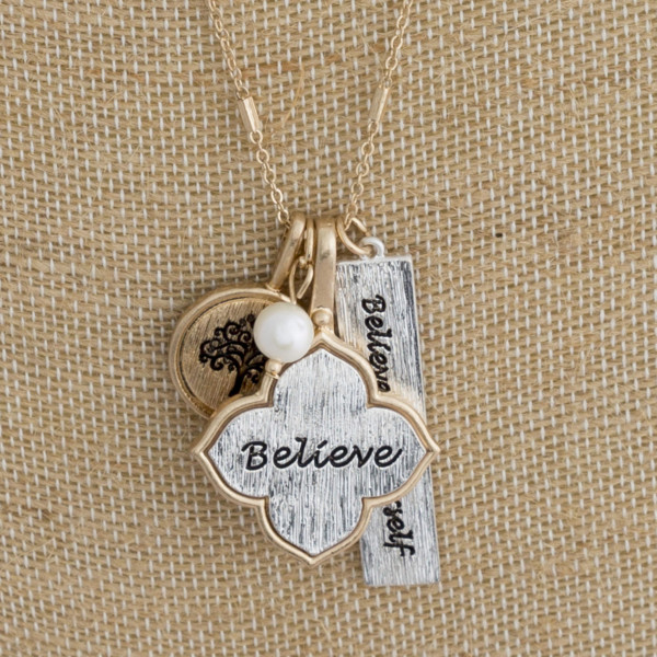 "Long metal necklace with believe in yourself message. Approximate 24"" in length."