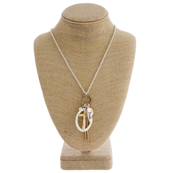 """Long silver chain necklace featuring a """"cross"""" pendant with a pearl and tassel accent. Approximately 36"""" in length."""