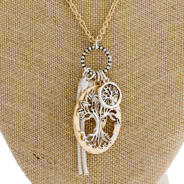 """Long gold chain necklace featuring a """"tree of life"""" pendant with a pearl and tassel accent. Approximately 36"""" in length."""
