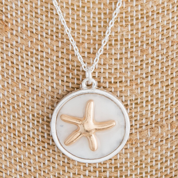 "Long metal necklace featuring mother of pearl pendant with a starfish detail. Pendant approximately .5"". Approximately 18"" in length."