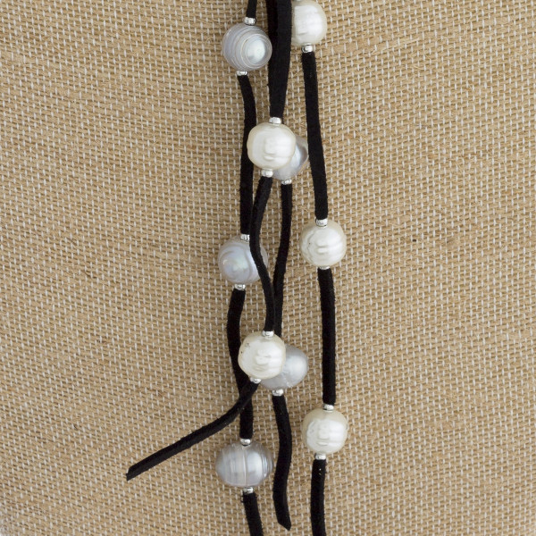 """Long leather beadedY necklace with pearls. Approximate 24"""" in length."""