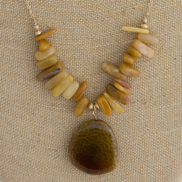 "Long metal necklace with natural stone pendant. Approximate 32"" in length."