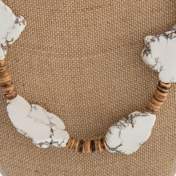 """Long wood beaded necklace featuring white tortoise howlite inspired stones. Approximately 32"""" in length."""