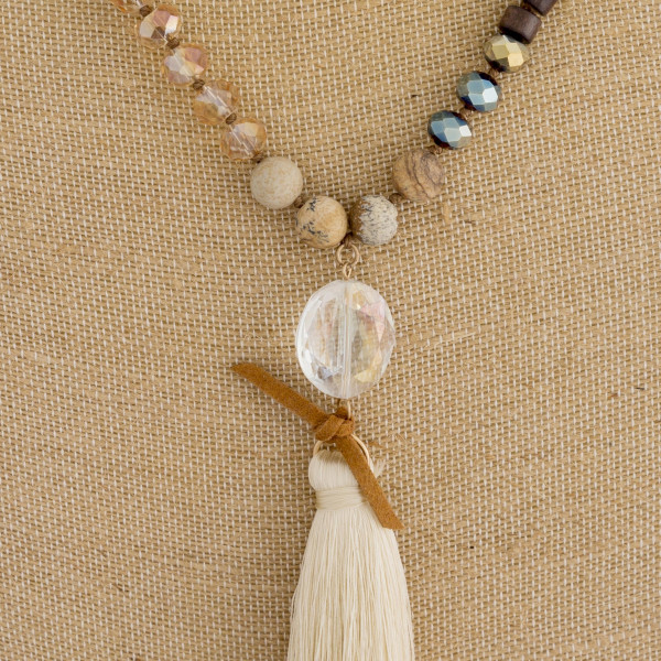 "Long beaded necklace with  engraved pendant message blessed. Approximate 32"" in length."