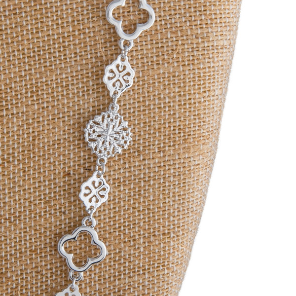 "Long metal necklace with filigree detail. Approximate 34"" in length."