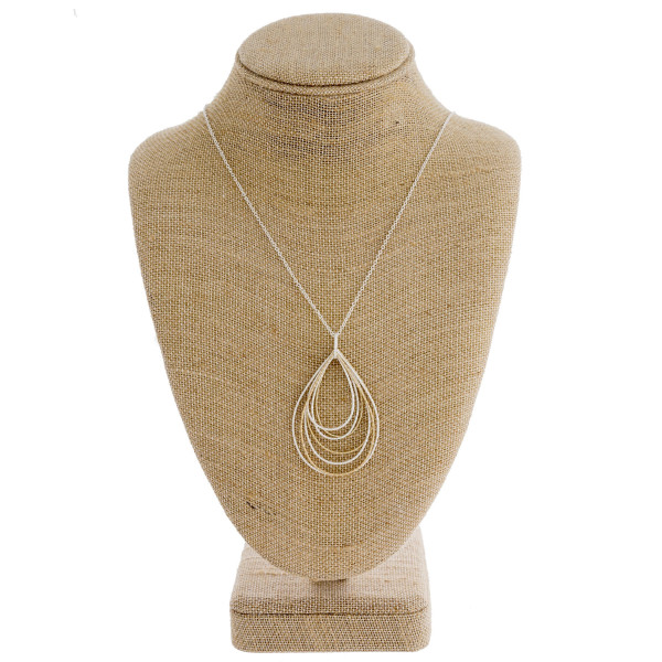 "Long silver chain necklace featuring a teardrop pendant with gold accents. Measures approximately 36"" in length."