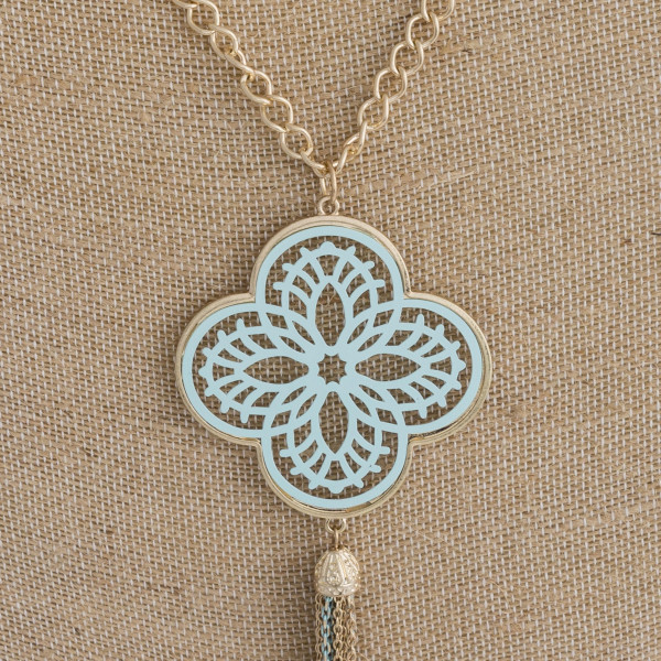 "Long necklace featuring a mint filigree pattern pendant with a tassel detail. Pendant approximately 6"" in length. Approximately 44"" in length overall."