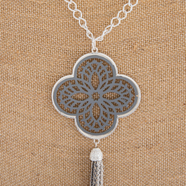 "Long necklace featuring a grey filigree pattern pendant with a tassel detail. Pendant approximately 6"" in length. Approximately 44"" in length overall."