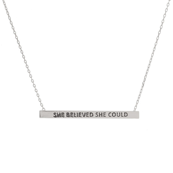 "Long metal necklace with bar pendant and message ""She Believed She Could"" engraved. Approximate 17.5"" in length."