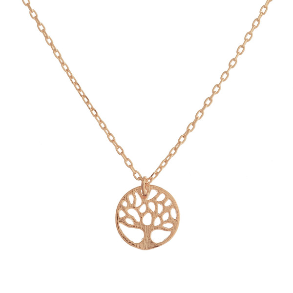 "Long metal dainty necklace with tree of life pendant. Approximate 17"" in length."