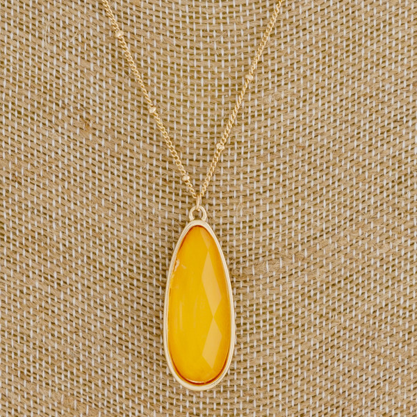 "Dainty satellite chain necklace featuring a iridescent acrylic stone teardrop pendant. Pendant 1.25"". Approximately 20"" in length overall."