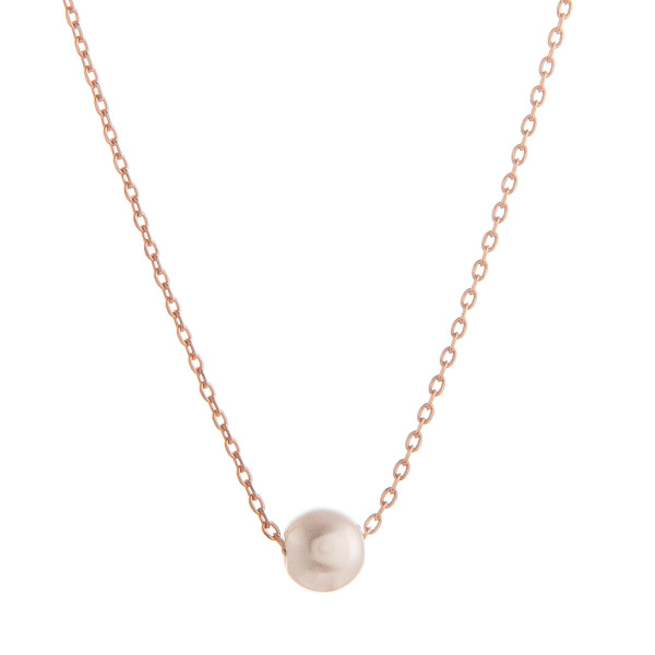 "Long metal necklace with pearl pendant. Approximate 17.5"" in length."