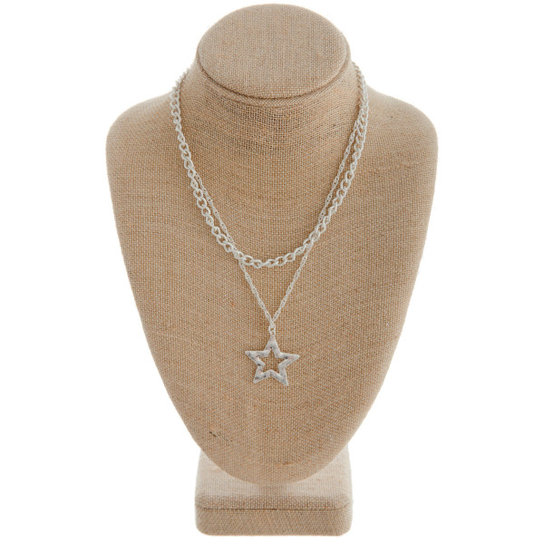 "Silver layered necklace featuring a star pendant. Measures approximately 20"" in length."