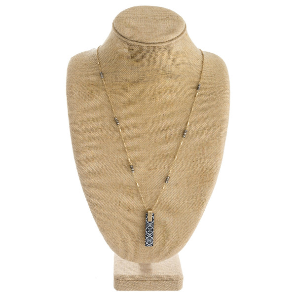 "Long link bar chain necklace featuring a wood inspired pattern bar pendant with beaded accents. Pendant approximately 2"". Approximately 36"" in length overall."